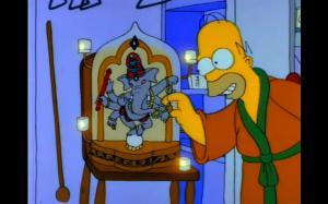 Home Feeding Ganesh a Peanut